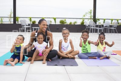 Young black kids in yoga class