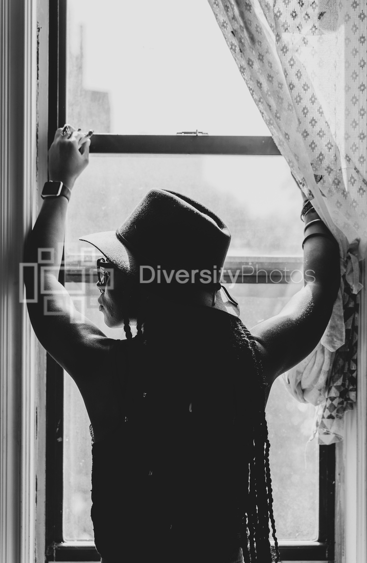 Woman thinking and looking out window