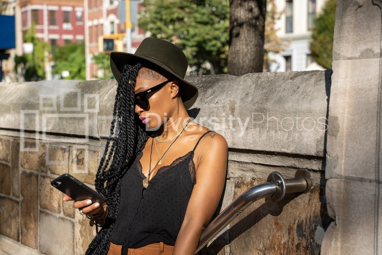 Woman checking smartphone outdoors