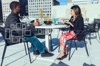 Black man and Pakistani woman having casual business meeting