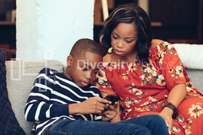 Mother and Son playing game on couch