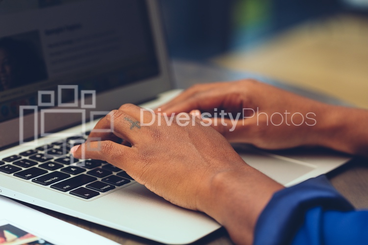 Black woman working on laptop