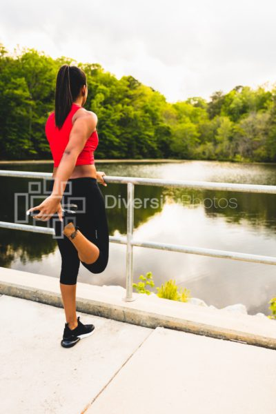 Black woman stretching before running