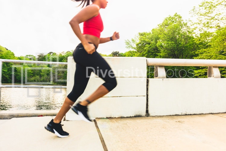 Black woman jogging with motion blur