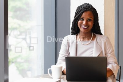 Black professional woman working on laptop