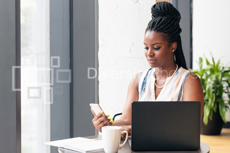 blakc woman checking her messages