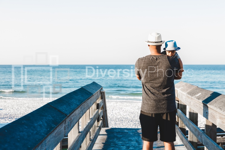 Black father and son on boardwalk