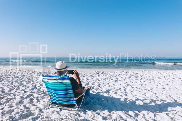 Black man relaxing on the beach