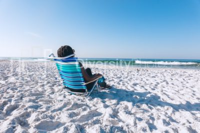 Black woman relaxing on the beach