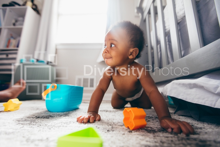 Black baby playing at home