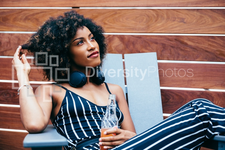 Woman relaxing outdoors on rooftop