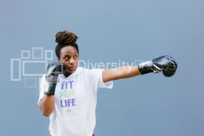 Young female boxer throwing punch
