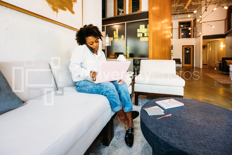 Woman working on laptop in coworking space