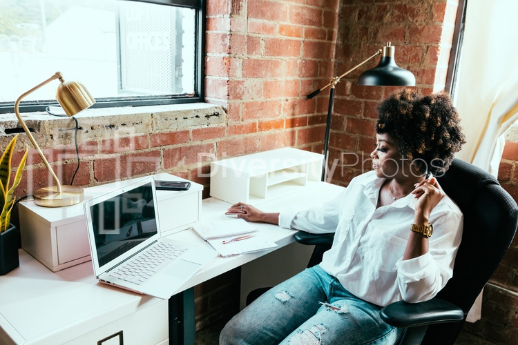 Young woman working in loft office