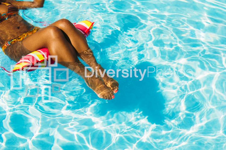 Black woman relaxing in pool