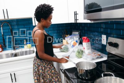Woman preparing meal for family in kitchen