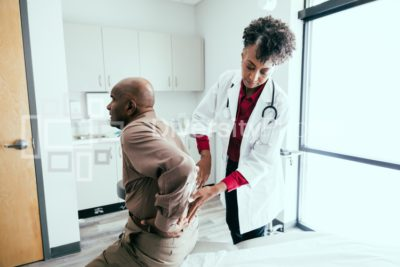Doctor checks for pain and swelling