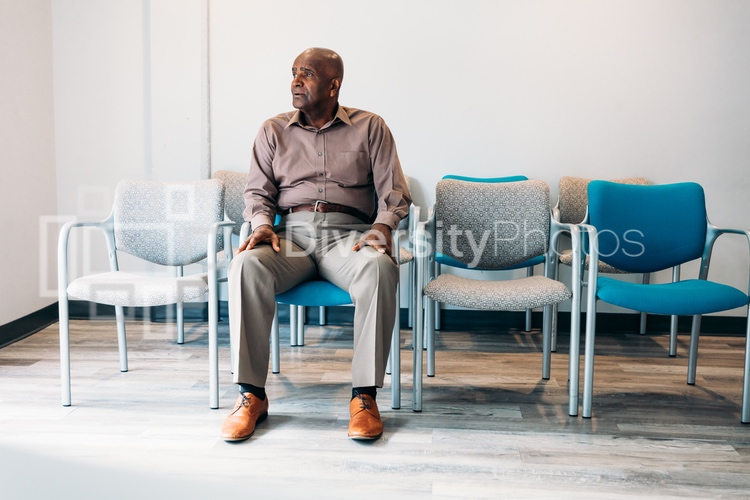 Mature man waiting in medical office