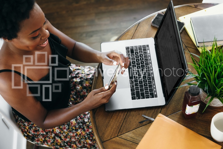 Woman working remotely from home on smartphone