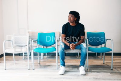 Gen Z boy sitting in doctors wait area