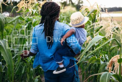 Mother and son walks through corn field