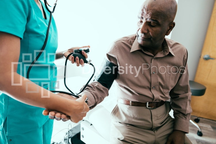 Doctor checking heart rate and blood pressure
