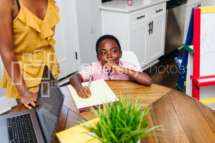 Mother teaching kids at home during pandemic