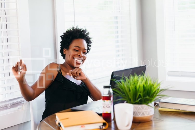Woman excited after successful video chat meeting working from home