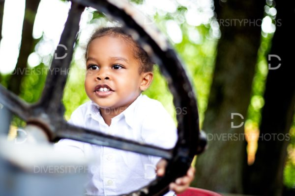 Toddler portrait on family farm tractor