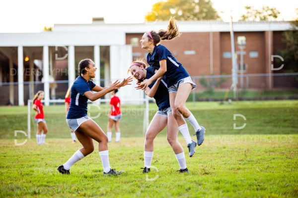 Teen girls celebrating after successful game victory