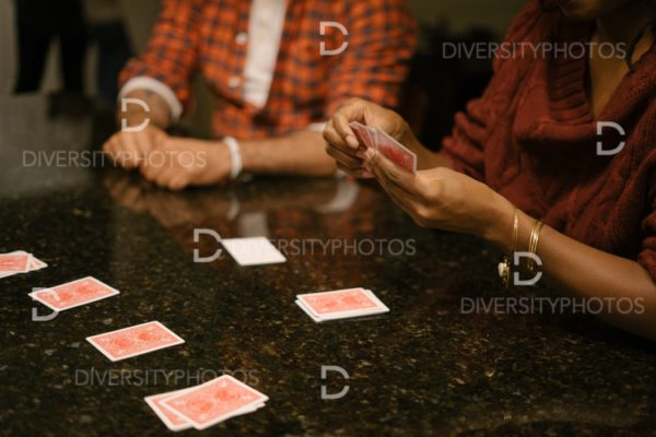 African American friends together playing card games