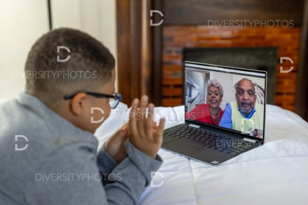 Young boy having video chat with grandparents on Christmas